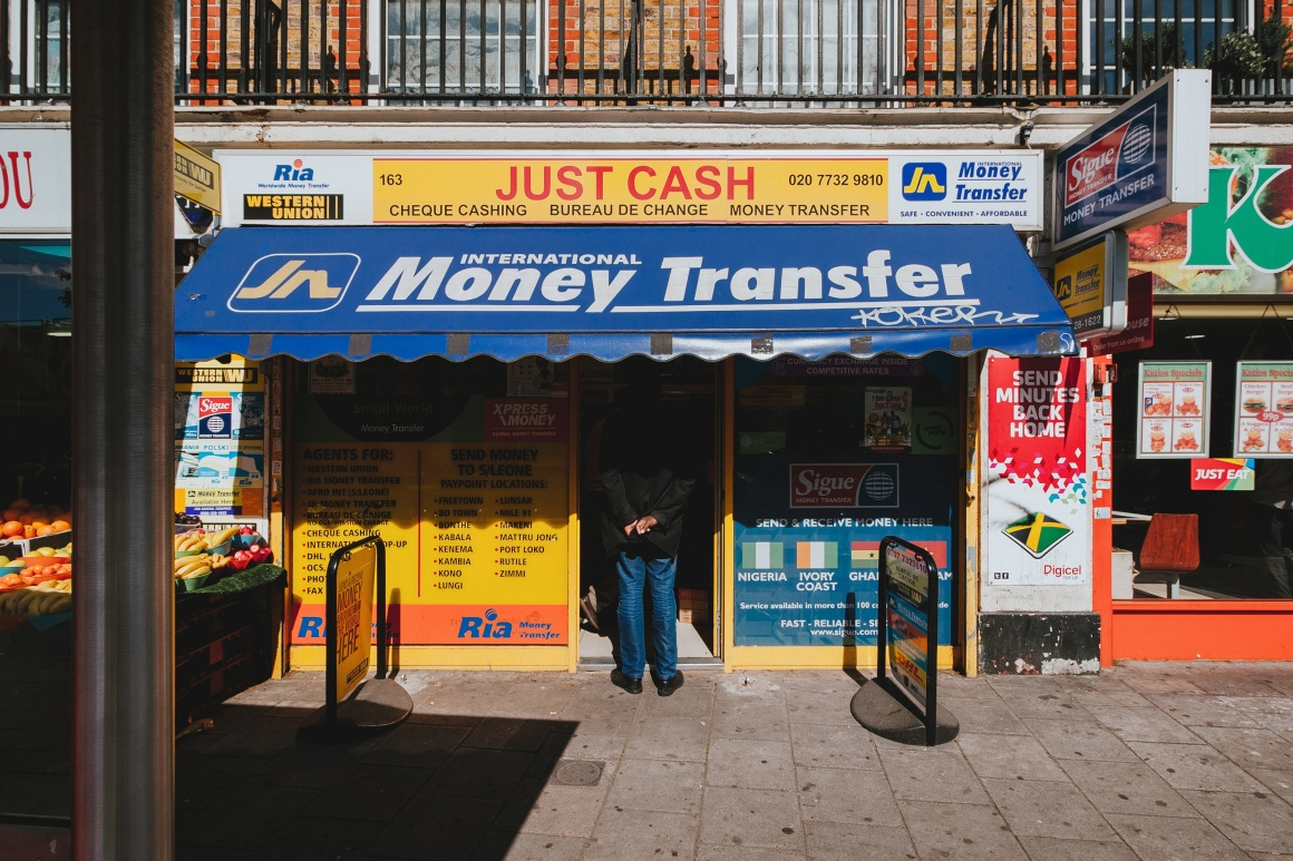 Money Transfer; Copyright: Alistair MacRobert/Unsplash...